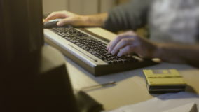 Man PC keyboard typing routine stock footage