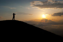 Man at the peak Stock Images