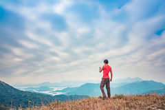 Man on the peak. Hiking in Autumn Stock Photo