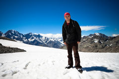 Man on peak of Mount Cook in New Zealand Stock Photography