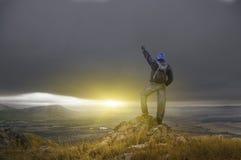 Man on peak of mountain. Stock Photos