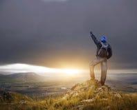 Man on peak of mountain. Royalty Free Stock Photography