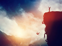 Man on the peak of mountain against others struggling to climb. Winner, competition Royalty Free Stock Photo