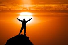 Man on peak of mountain. Royalty Free Stock Image