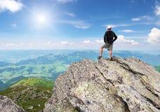 Man on peak of mountain. Royalty Free Stock Images