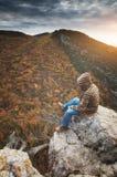 Man on peak of mountain royalty free stock photo