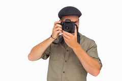 Man in peaked cap taking photo Royalty Free Stock Photos