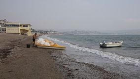 Man with pedalos Weymouth beach Dorset UK in late summer stock video