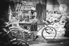 A man peddles a cycle rickshaw Royalty Free Stock Images