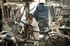 A man peddles a cycle rickshaw Stock Photos