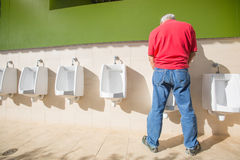 A man peeing standing up Royalty Free Stock Photos