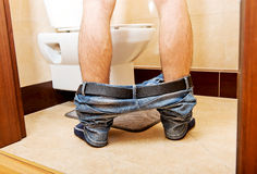 Man peeing in toilet at home Stock Photo