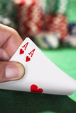 Man peeked at two cards close up of hand Stock Photography
