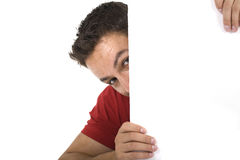 Man peeking behind empty white billboard Royalty Free Stock Photo