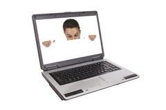 Man peeking behind empty white billboard Stock Photo