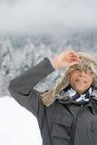Man peeking through a deerstalker hat Stock Images