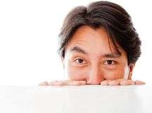 Man peeking over a table Stock Images