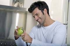 Man peeling an apple Stock Image