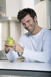 Man peeling an apple Stock Photo