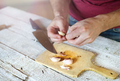 Man peeling garlic Stock Photo