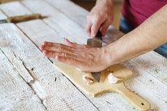 Man peeling garlic Stock Images