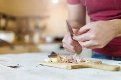 Man peeling garlic Stock Photography