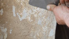 Close Up Of Man S Hand Peeling A Paint On An Old House Wall