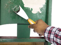 Man peeling paint Stock Photos