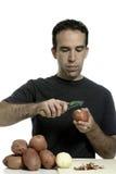 Man Peeling Potatoes Stock Photos