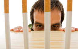 Man peeping from behind the table Stock Image