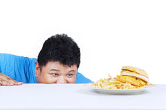 Man is peeping hamburger 1 Stock Photo
