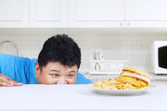 Man is peeping hamburger Stock Photos