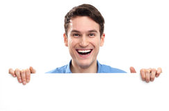 Man peeping over blank poster Royalty Free Stock Photos