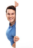 Man peeping over blank poster Royalty Free Stock Photography
