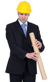 Man peering down a cardboard tube Royalty Free Stock Photography