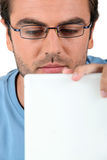 Man peering at his laptop Stock Photo