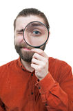 Man Peering through Magnifying Glass Stock Photography
