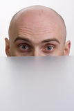 Man peering over a cubicle Royalty Free Stock Image