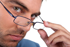 Man peering over his glasses Royalty Free Stock Photo