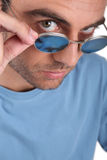 Man peering over his sunglasses Stock Photos