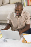 Man with pen in mouth at laptop computer, elevated view Royalty Free Stock Photography