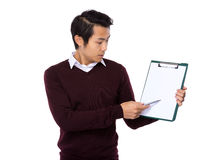 Man with pen point to clipboard Royalty Free Stock Photography