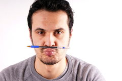 Man with pen Royalty Free Stock Images