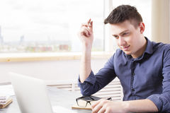 Man with pen using laptop Stock Photo