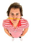 Man with pencil under his nose Stock Images