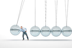 Man and pendulum Royalty Free Stock Image