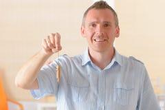 Man with pendulum. Man dowser using wooden pendulum, tool for dowsing Royalty Free Stock Photo