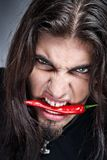 Man with pepper in his mouth Royalty Free Stock Image