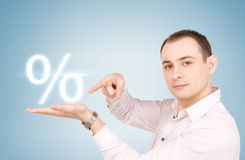 Man with percent sign stock image