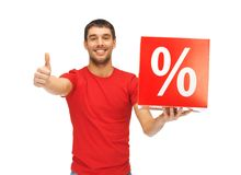 Man with percent sign. Handsome man with percent sign showing thumbs up Royalty Free Stock Images
